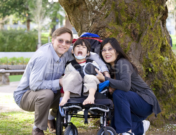 Disabled child surrounded by parents Stock photo © jarenwicklund