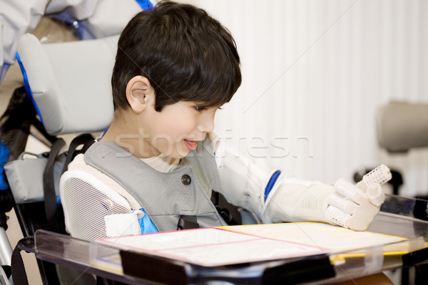 Five year old disabled boy studying in wheelchair Stock photo © jarenwicklund