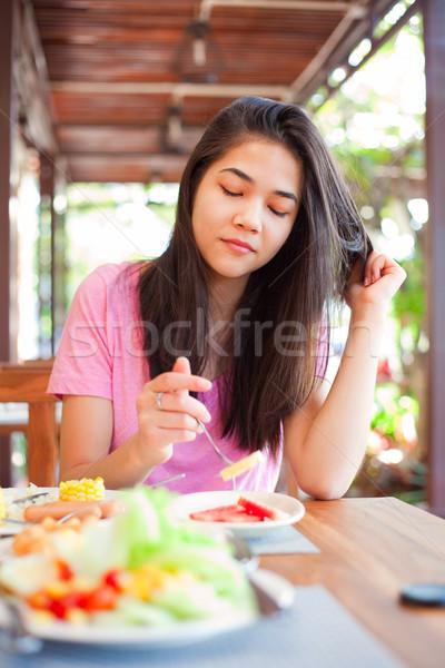 Teen girl eating breakfast on outdoor veranda Stock photo © jarenwicklund