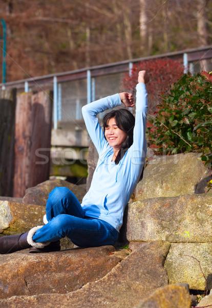 小さな 十代の少女 座って 岩 屋外 ストックフォト © jarenwicklund