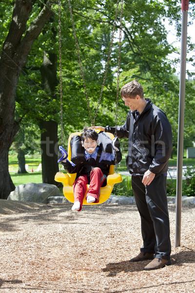 Apa toló mozgássérült fiú fogyatékos hinta Stock fotó © jarenwicklund