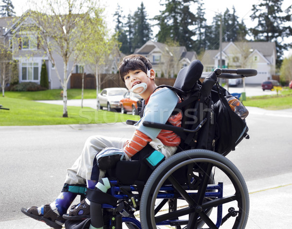Happy little disabled boy in wheelchair Stock photo © jarenwicklund