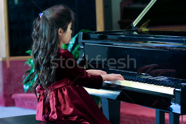 Child playing piano Stock photo © jarenwicklund