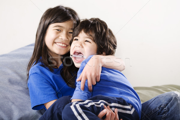 Big sister holding her disabled little brother Stock photo © jarenwicklund