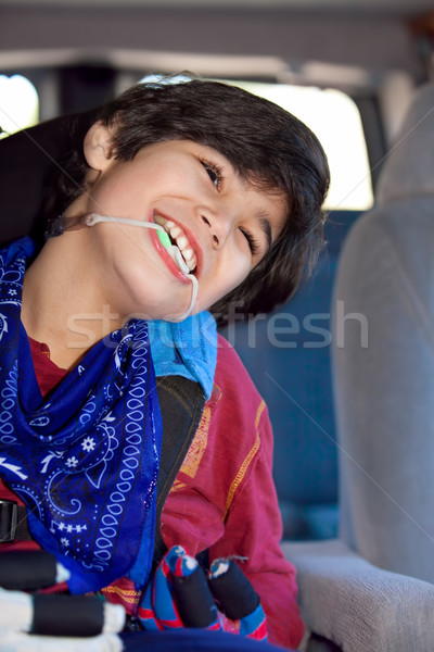 Disabled little boy sitting in carseat inside vehicle Stock photo © jarenwicklund