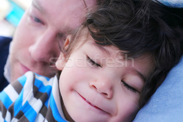 Beautiful baby boy ready for a nap with his Daddy. Stock photo © jarenwicklund
