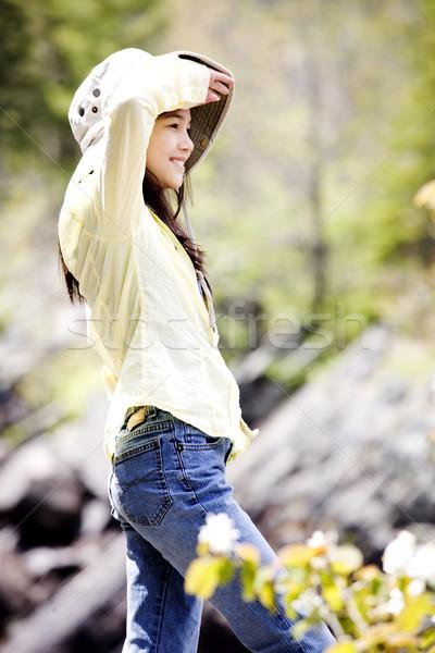 Girl standing on mountain looking around Stock photo © jarenwicklund