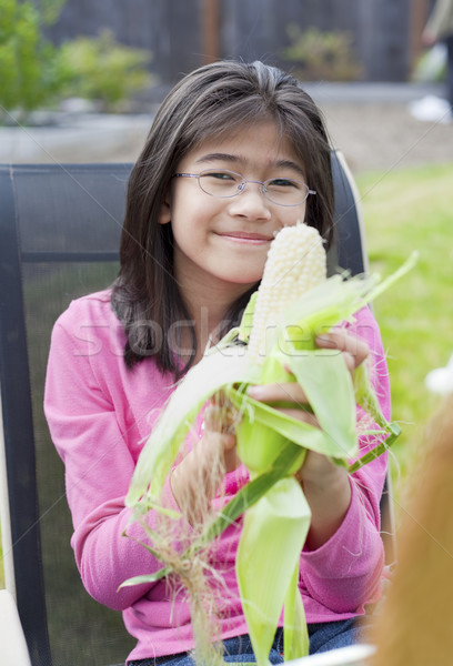 Girl peeling husk off corn cob Stock photo © jarenwicklund