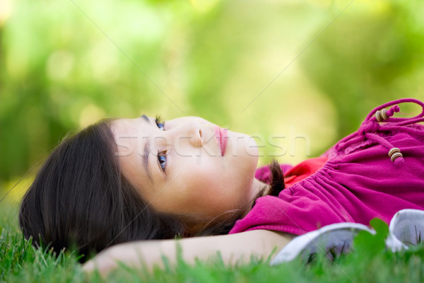 Little girl lying on grass Stock photo © jarenwicklund