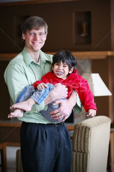 Father holding his disabled three year old son Stock photo © jarenwicklund