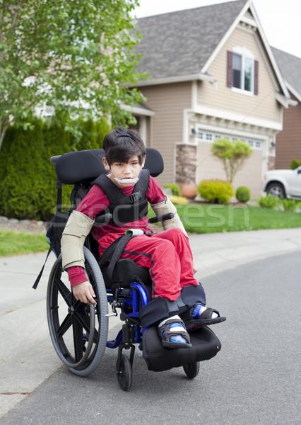 Сток-фото: инвалидов · мало · мальчика · коляске · улице