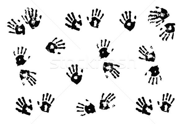 Black handprints made by children on white background.; Stock photo © jarenwicklund