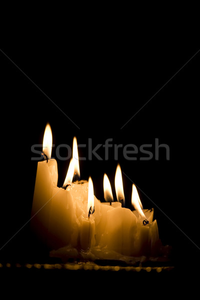 Group of white candles burning in the dark Stock photo © jarenwicklund