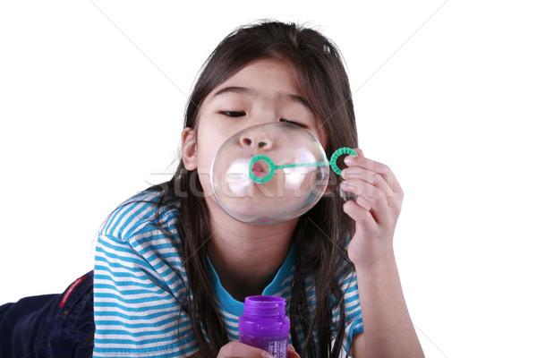 Kislány buborékfújás kicsi lány gyermek jókedv Stock fotó © jarenwicklund