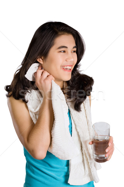 Beautiful biracial teenage girl drinking water while wiping off  Stock photo © jarenwicklund