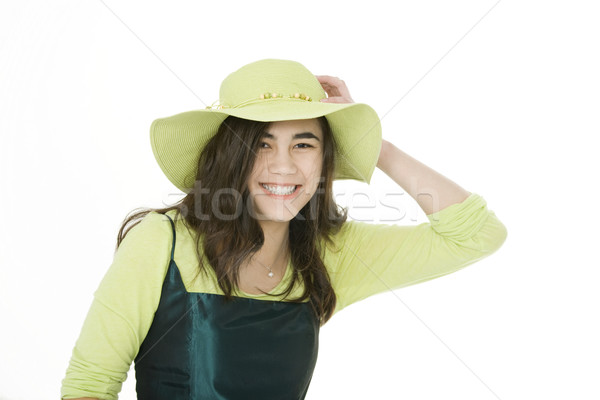 Smiling teen girl in green dress and lime green hat Stock photo © jarenwicklund