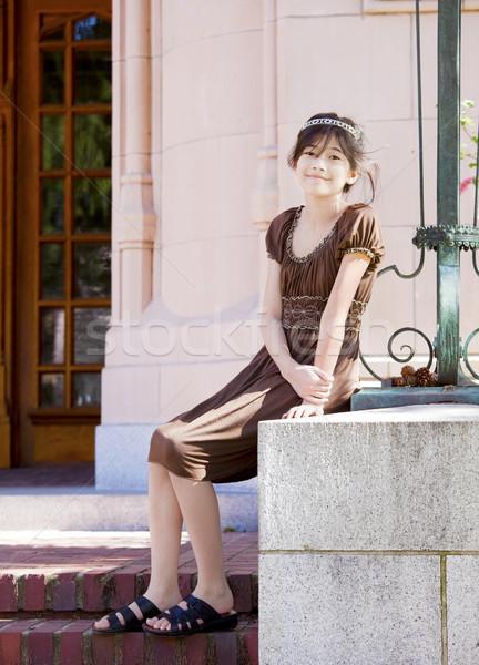 Preteen girl enjoying sunshine on stone steps outdoors Stock photo © jarenwicklund