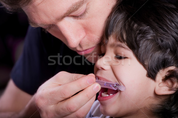 Father helping his disabled son Stock photo © jarenwicklund