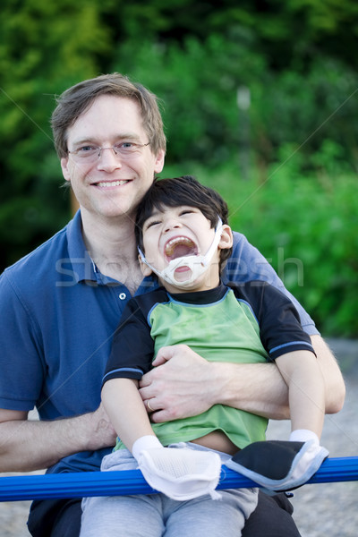 Father holding disabled son at playground Stock photo © jarenwicklund