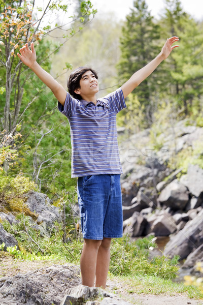 Teenage boy raising hands in praise Stock photo © jarenwicklund