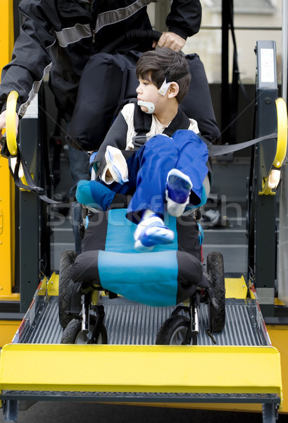 Disabled boy on school bus wheelchair lift  Stock photo © jarenwicklund
