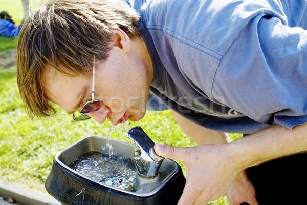 Man drinking water from fountain Stock photo © jarenwicklund