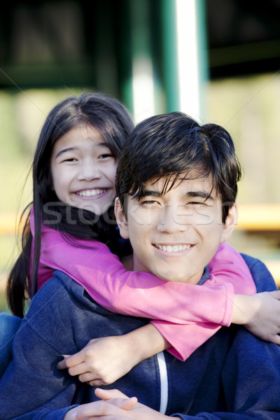 Younger sister hugging big brother Stock photo © jarenwicklund