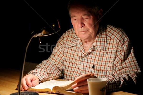 ELderly man reading Bible  at night Stock photo © jarenwicklund