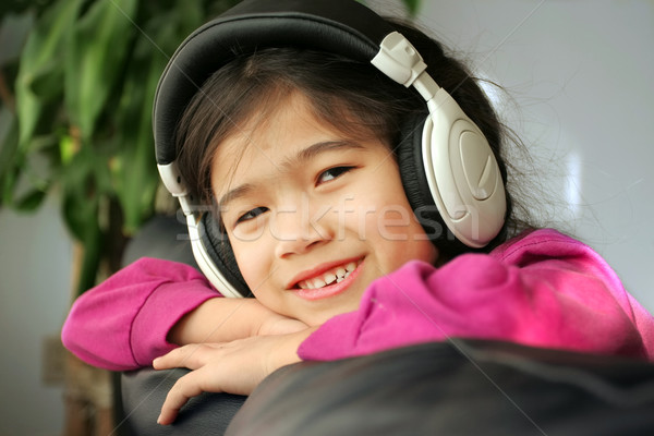 Six year old listening to music Stock photo © jarenwicklund