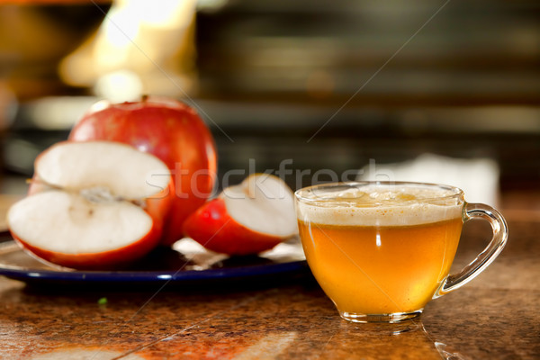 Glass cup of freshly juiced apple on kitchen counter next to pla Stock photo © jarenwicklund