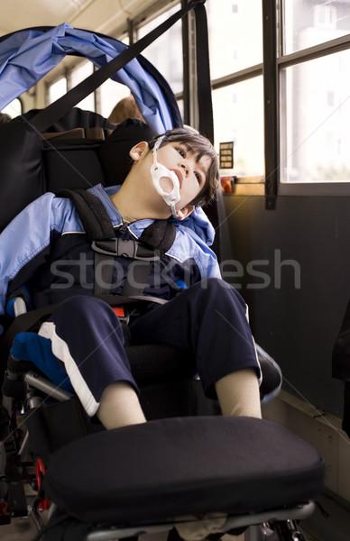 Disabled little boy sitting in wheelchair on school bus Stock photo © jarenwicklund