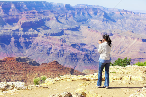 Teen girl taking pictures at the Grand Canyon Stock photo © jarenwicklund