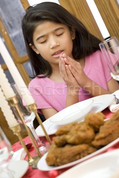 Girl praying during dinner Stock photo © jarenwicklund