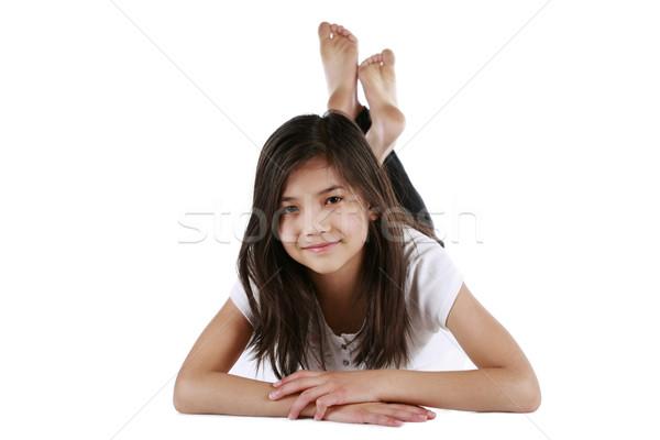 Beautiful ten year old biracial girl happily relaxing on floor Stock photo © jarenwicklund