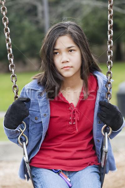 Angry, sad preteen girl sitting on swing Stock photo © jarenwicklund