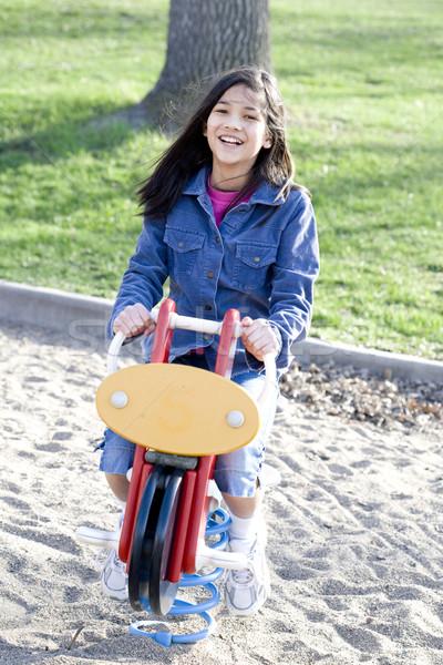 Fille jouer aire de jeux cheval à bascule sable amusement Photo stock © jarenwicklund