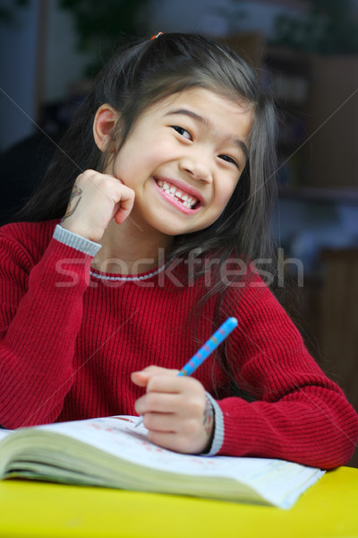 Child doing her homework Stock photo © jarenwicklund