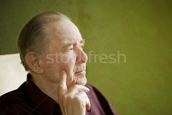 Elderly man in rocking chair looking out sunny window Stock photo © jarenwicklund
