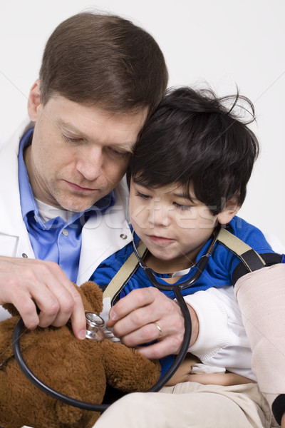 Male doctor interacting with disabled  toddler patient on lap Stock photo © jarenwicklund
