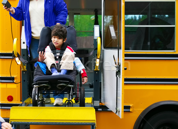 Disabled five year old boy using a bus lift for his wheelchair Stock photo © jarenwicklund