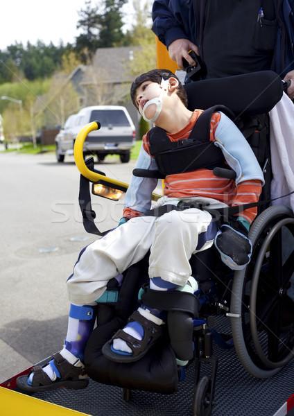 Disabled boy on school bus wheelchair lift  Stock photo © jarenwicklund