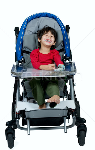 Three year old biracial disabled boy in medical stroller, happy  Stock photo © jarenwicklund
