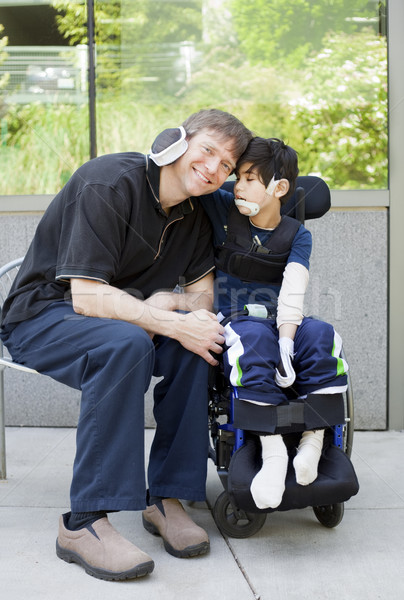 Disabled boy hugging father while waiting at hospital Stock photo © jarenwicklund