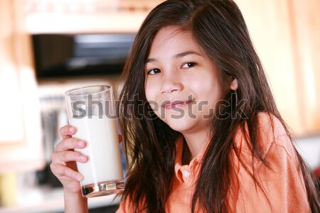 Beautiful young biracial girl drinking milk Stock photo © jarenwicklund