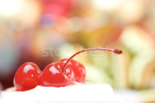 Cherries on top of frosted cake Stock photo © jarenwicklund