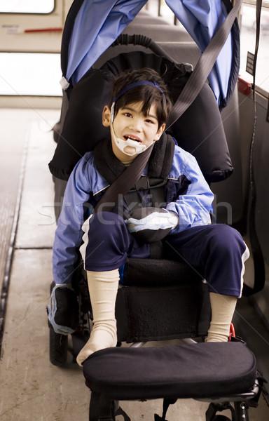 Disabled little preschool boy in wheelchair on bus Stock photo © jarenwicklund