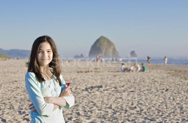 Beautiful biracial girl on sandy beach near Haystack Rock Stock photo © jarenwicklund