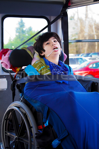 Disabled eight year old boy in wheelchair buckled on school bus Stock photo © jarenwicklund