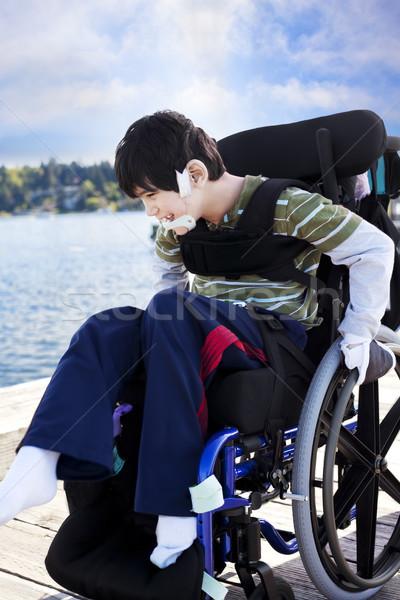 Handicapées peu garçon fauteuil roulant sur pier Photo stock © jarenwicklund