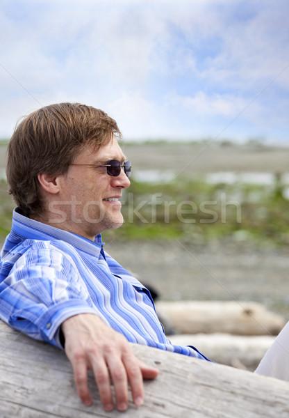 Caucasiano homem quarenta anos relaxante ao ar livre praia Foto stock © jarenwicklund